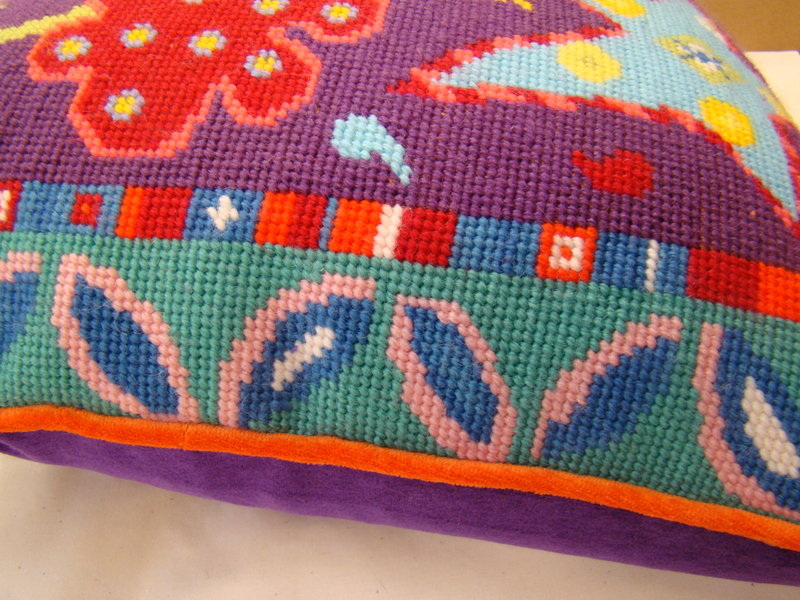 Carnival, orange piping and purple backing